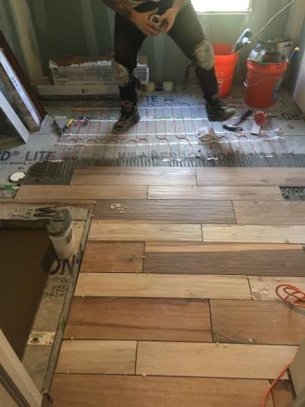 farmhouse bathroom renovation wood look tile flooring