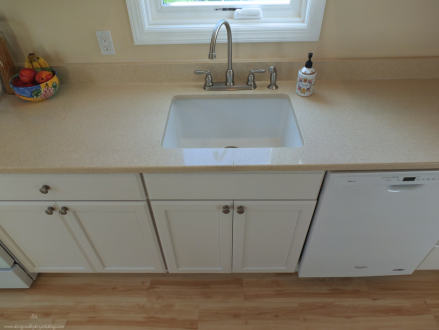 warm white kitchen galley kitchen zodiac counter granite composite sink
